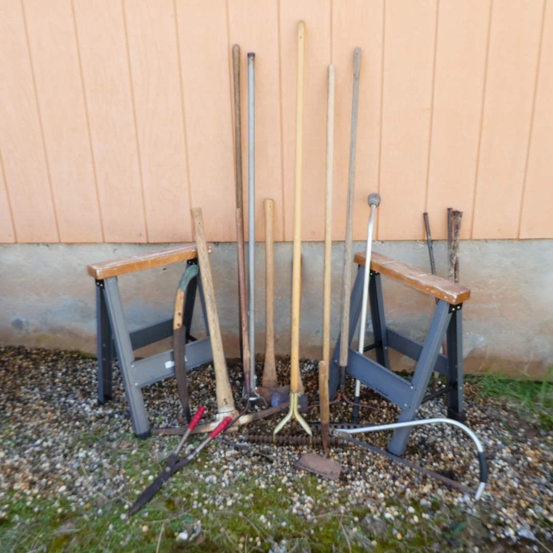 Lot # 245 - Large Yard Tools Lot -- Hirsh Saw Horses, Axes(one Plumb),Loop Hoes, Saws and More (See all Photos)  (main image)
