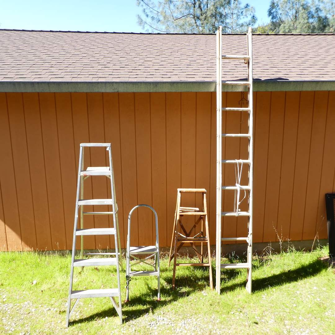 Lot # 249 - 20 Ft. Extension Ladder, 6 Ft. Metal Folding Ladder, 4 Ft Wooden Folding Ladder and Metal Folding Step Ladder (main image)
