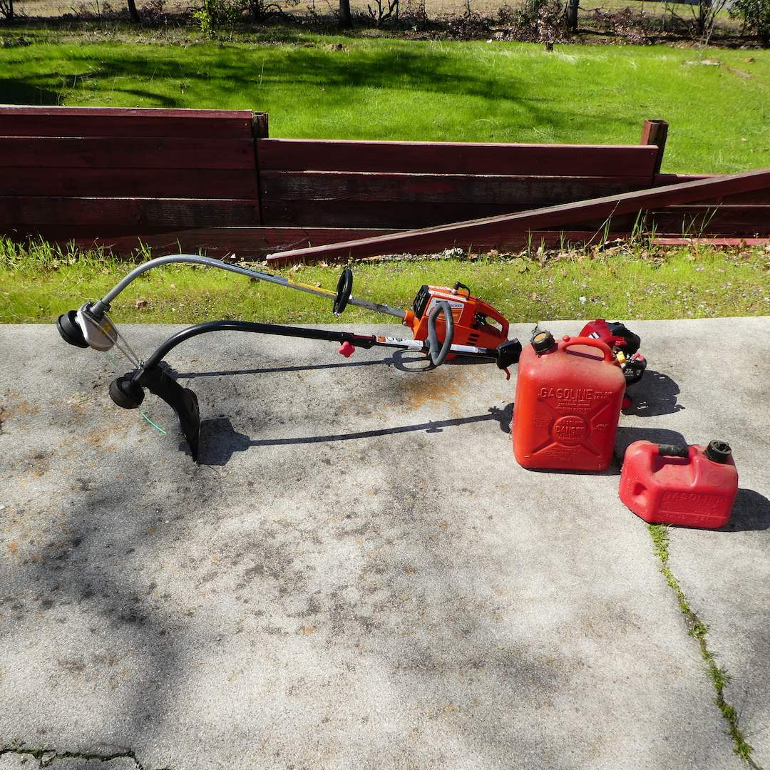 Lot # 253 - Two Weed Eaters (Craftsman Runs, Brushwacker Has Compression) and Two Empty Gas Cans  (main image)