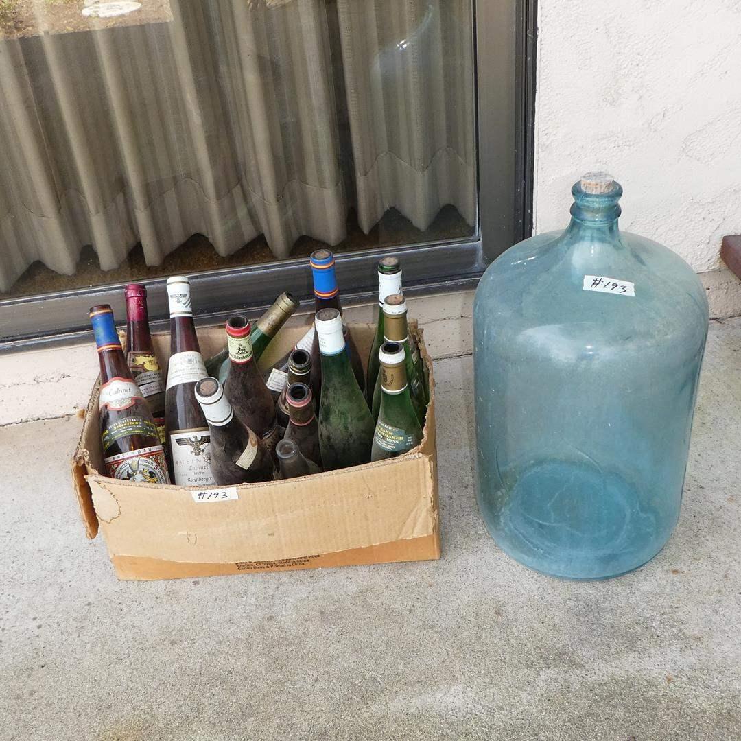 Lot # 193 - Vintage 5 Gallon Water Bottle & Empty Wine Bottles Collection (main image)