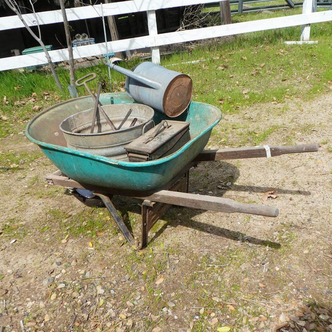 Lot # 202 - Ammo Box, Watering Can, Branding Iron, Lead Melting Ladles, Galvanized Bucket & Wheelbarrow (main image)