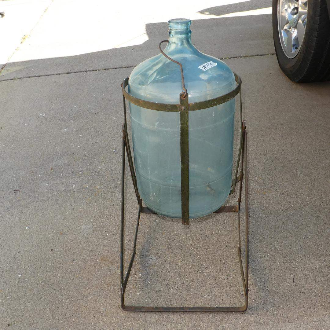 Lot # 113 - Vintage 5 Gallon Glass Water Bottle on Antique Metal Tilt Cradle Holder (main image)