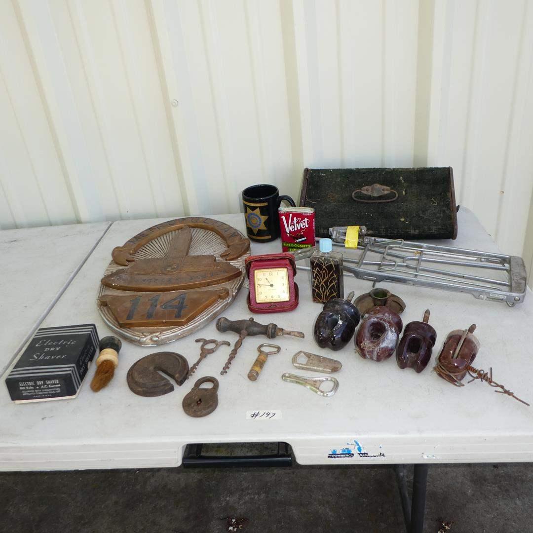 Lot # 147 - Los Angeles Police Plaster Plaque, Antique Car/Buggy Coal Foot Warmer, Schwinn Bike Rack, Cork Screws & Insulators (main image)