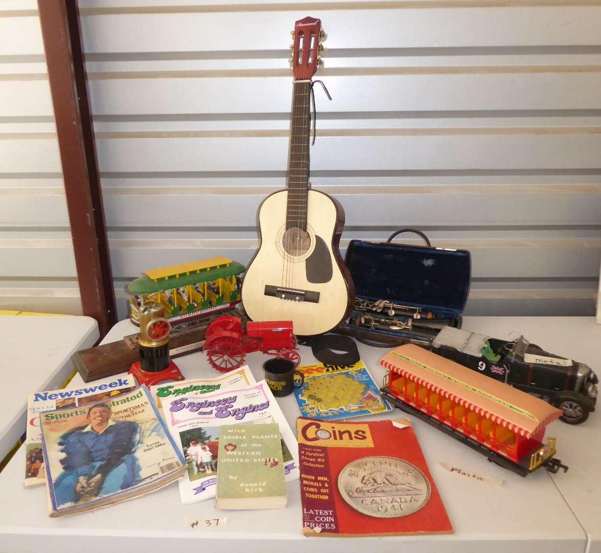 Lot # 37 - Collectibles Lot (Clarinet, Mini Guitar, Disney Trains & More)  (main image)