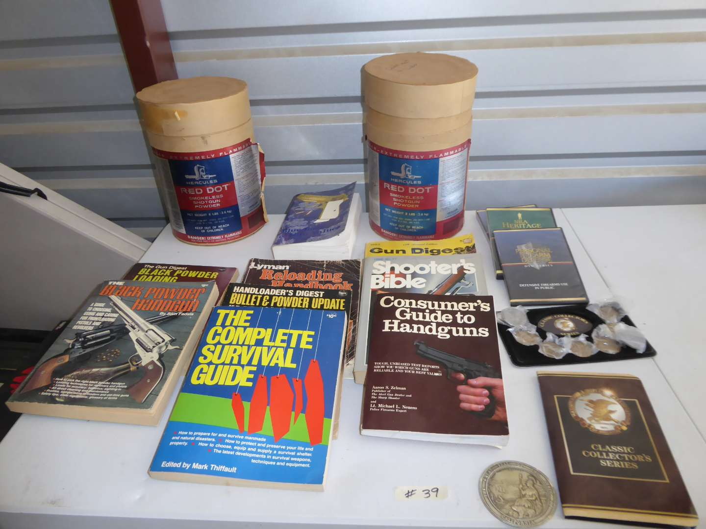 Lot # 39 - Red Dot Shotgun Powder Containers, Coins & Loading & Reloading Books  (main image)