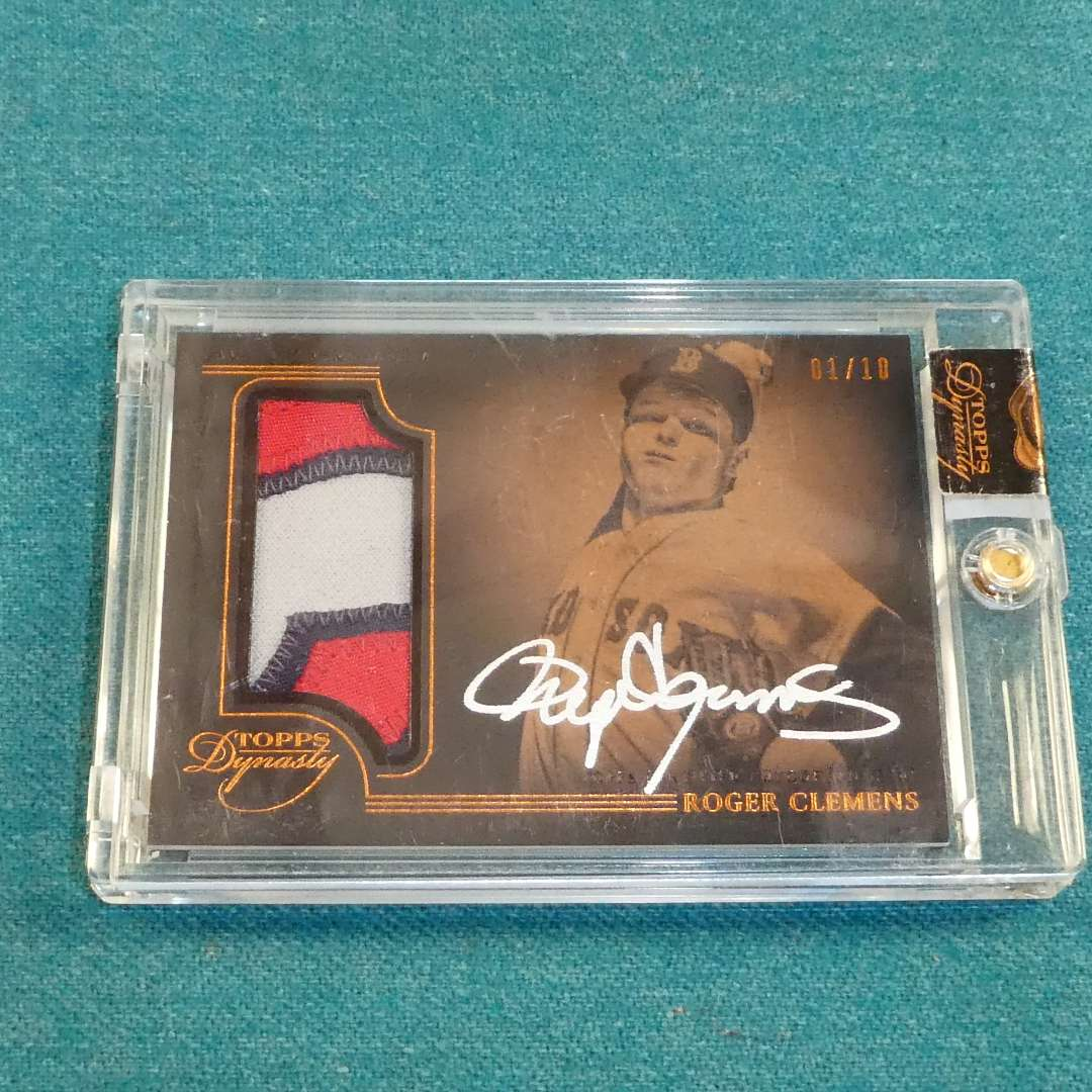 Lot # 272 - Topps Dynasty #1 Roger Clemens Autographed Game Used Jersey Baseball Card in Case  (main image)