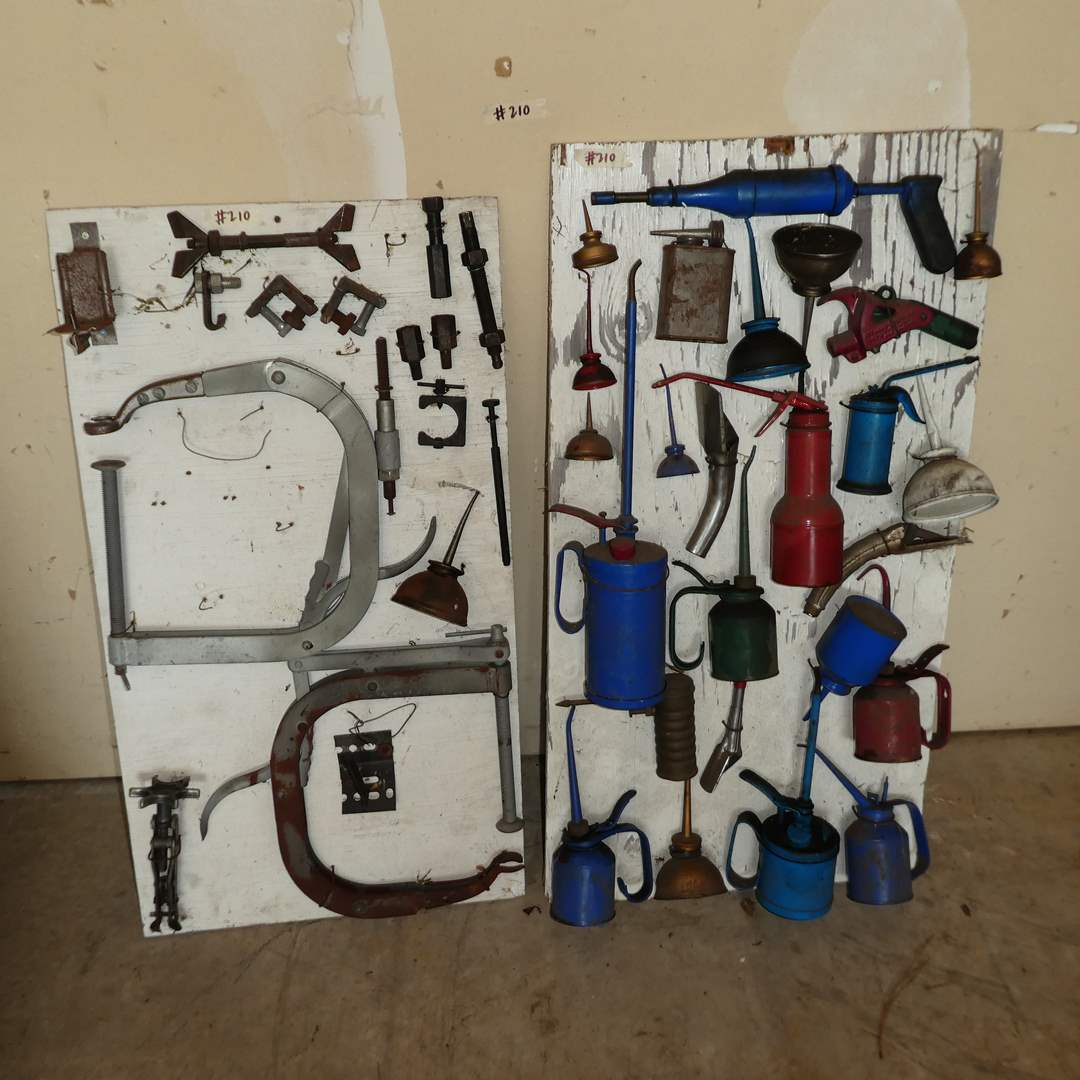 Lot # 210 - Vintage Oil Cans and Clamps Displayed on Wood  (main image)