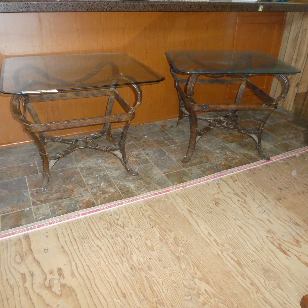 Lot # 2- Two Heavy Metal Horsebit Belt Base Side Tables w/ Glass Tops (One Glass Top Is Slightly Smaller Than The Other) (main image)
