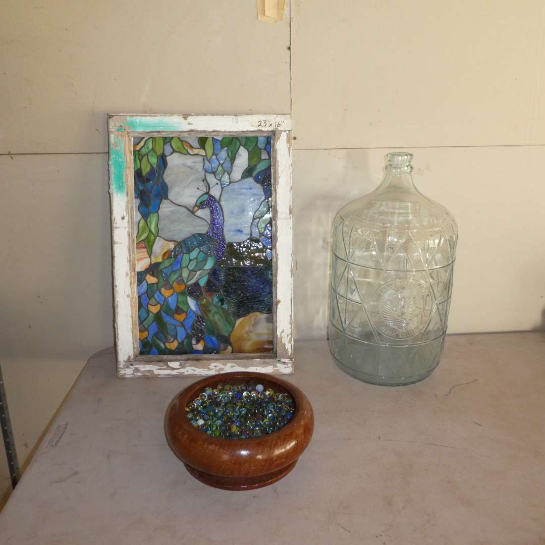 Lot # 10 - Framed Stained Glass Peacock, 5 Gallon Glass Water Bottle Made in Mexico and  Collection of Marbles  (main image)