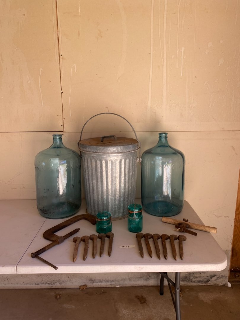 Lot # 19 - Two Vintage 5 Gallon Glass Water Bottles, Small Galvanized Metal Trash Can, Railroad Nails and More (main image)