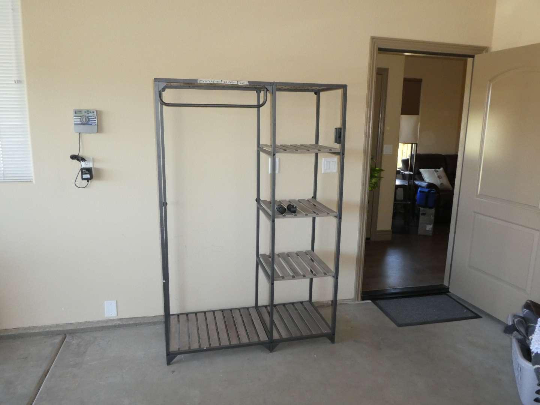 Lot # 251- Garment Rack w/ Shelves on Wheels (main image)