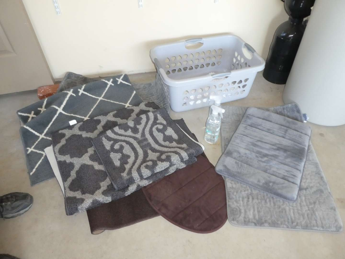 Lot # 254 - Variety of Bathroom Rugs, Laundry Basket and Method Shower Spray (main image)