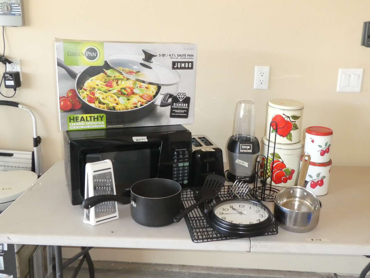 Lot # 258 - Kitchen Lot (Microwave, Cute Canisters, 5 Qt Green Pan, Toaster and More) (main image)