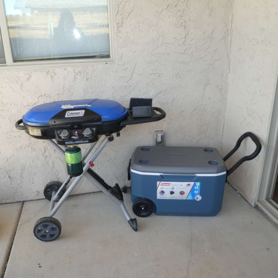 Lot # 216 - Coleman RoadTrip X- Portable Propane Grill and Rolling Coleman Ice chest  (main image)