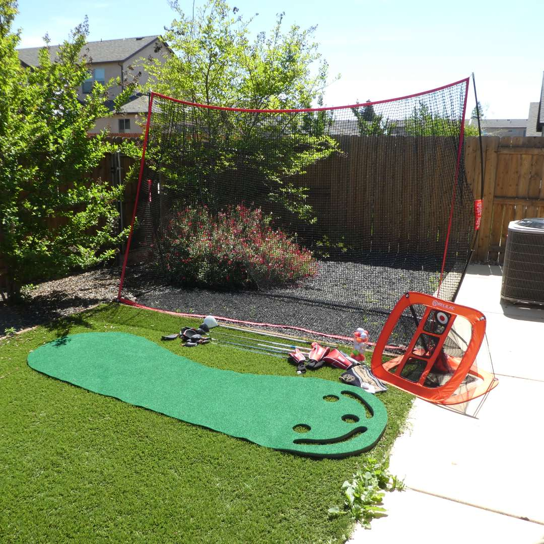 Lot # 222 - Large Sports Net, Indoor/ Outdoor 3 Hole Putting Green, Golf Clubs and More (main image)