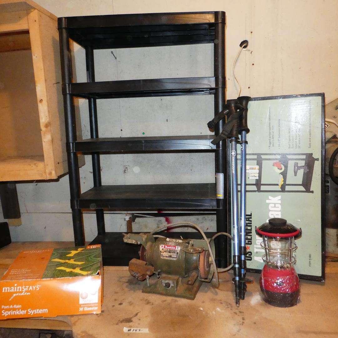 Lot # 142 - Port-A-Rain Sprinkler System, Bench Grinder, Lantern, Walking Sticks & Two 4-Tier Shelf Racks (main image)