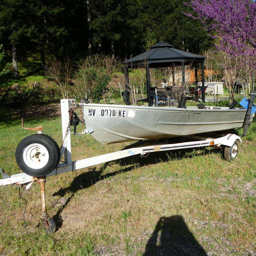 Lot # 146 - 12' Aluminum Fishing Boat on Trailer & Anchor (main image)