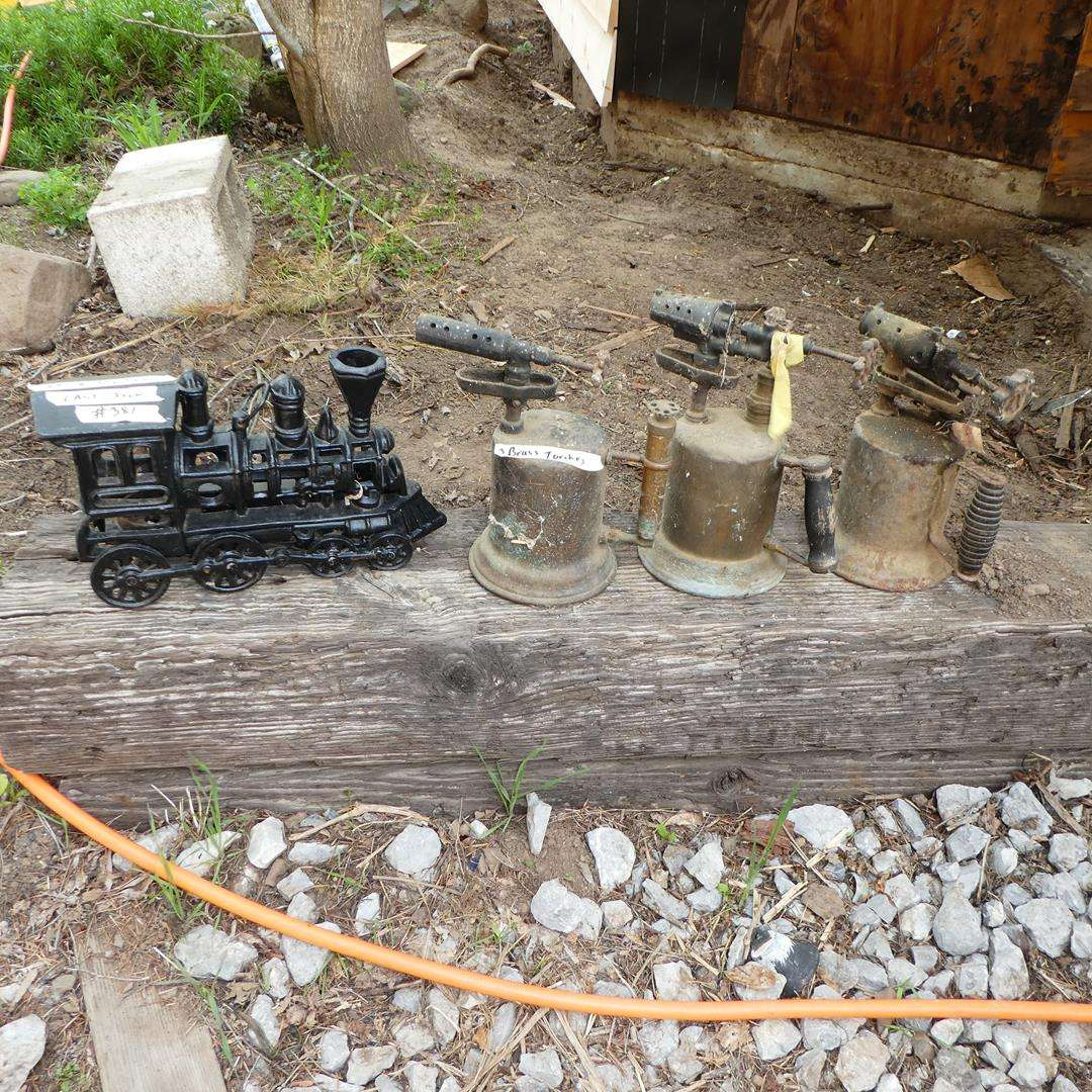 Lot # 381 - Cast Iron Train Candle Holder & Three Vintage Brass Torches (main image)