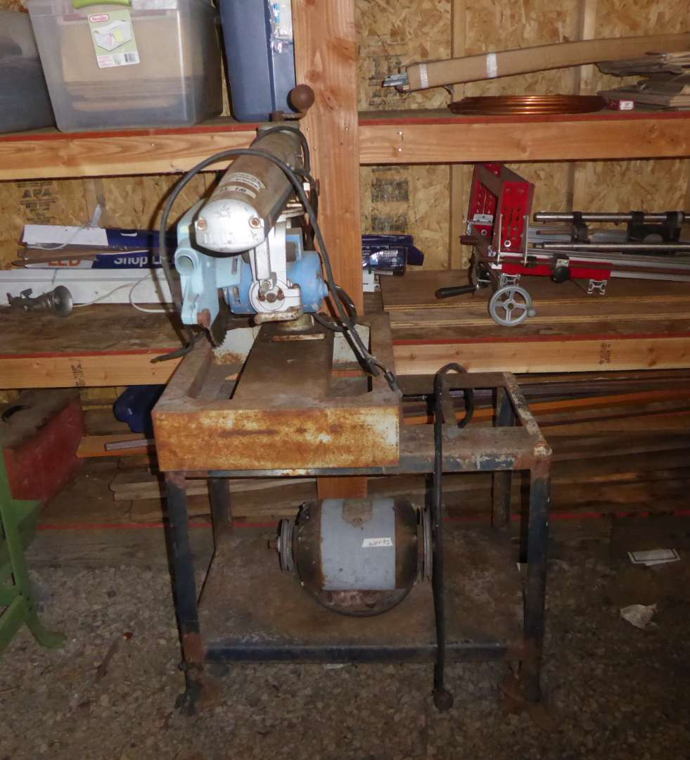 Lot # 18 - DEWALT Arm Saw & Stand With Attached Delta Motor  (main image)