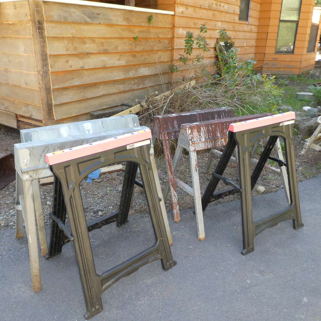 Lot # 61 - Three Sets of Folding Saw Horse ( One Set Plastic, Two Metal) (main image)