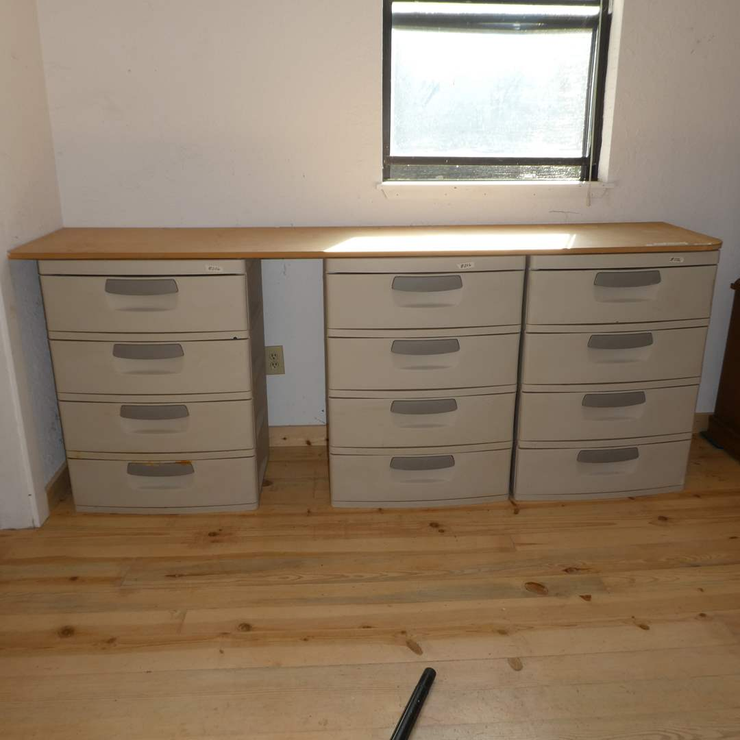 Lot # 206 - Three 4 Drawer Sterilite Units With Large Piece of Press Board (main image)