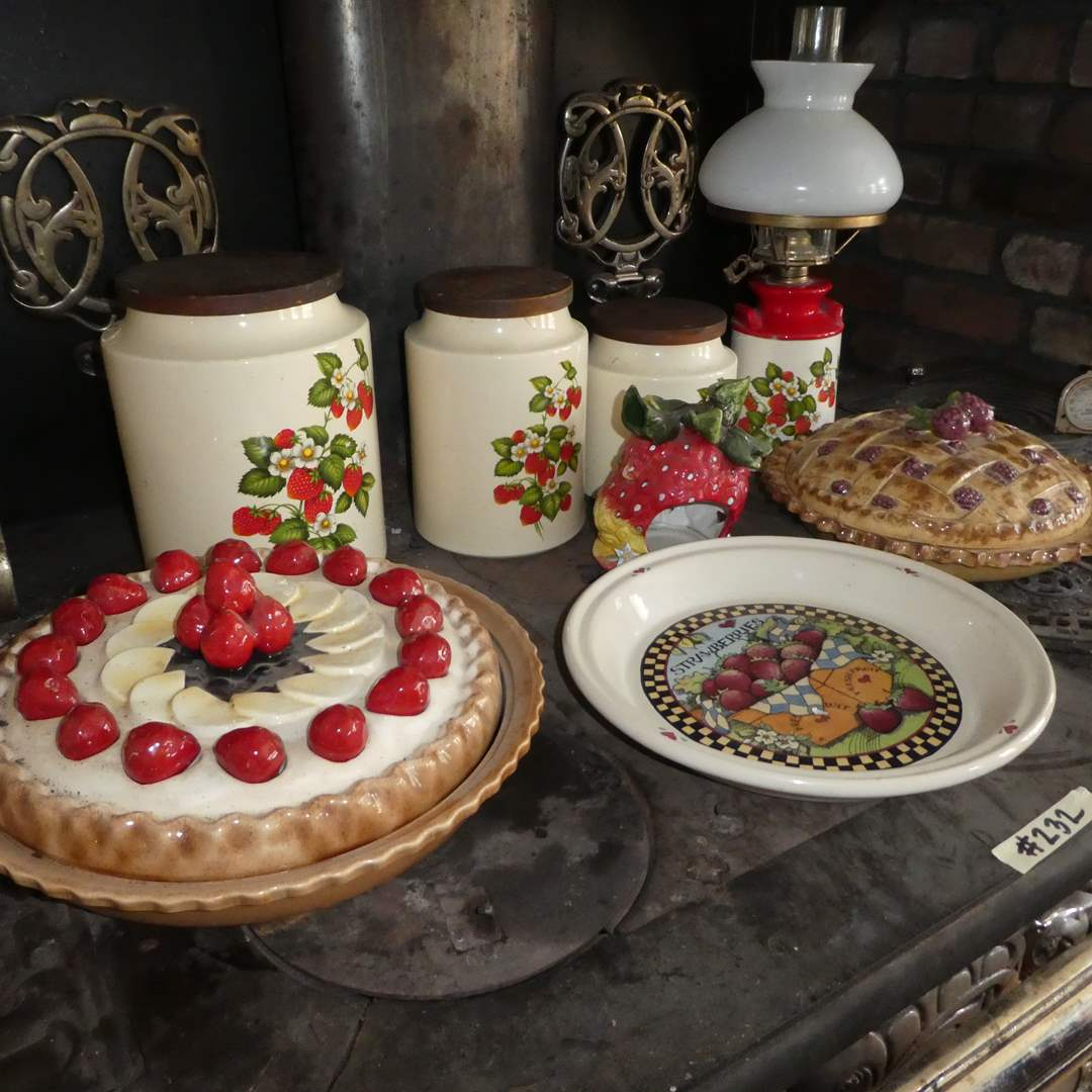Lot # 233 - Strawberry Lot- Pie Dishes with Lid, Oil Lamp and Canisters  (main image)