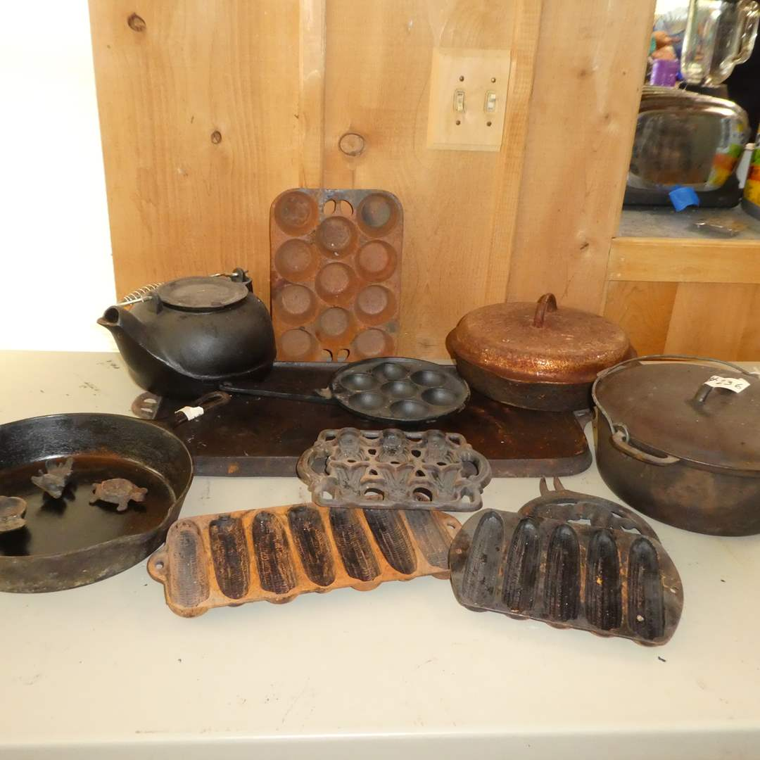 Lot # 236 - Variety of Cast Iron ( Pans, Pops, Trivets, Kettle, Griddle, Cornbread Pan and More) (main image)