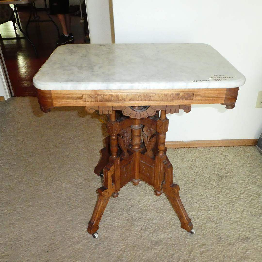 Lot # 102 - Antique Eastlake Marble Top Carved Wood Accent Table on Casters (main image)