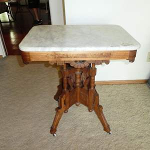 Lot # 102 - Antique Eastlake Marble Top Carved Wood Accent Table on Casters
