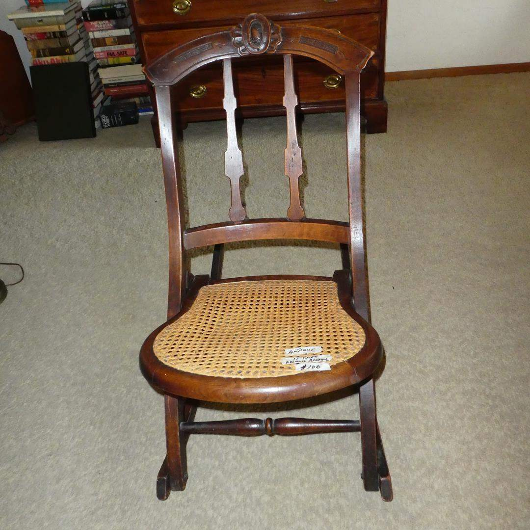 Lot # 106 - Antique Carved Wood Cane Seat Folding Rocking Chair (main image)