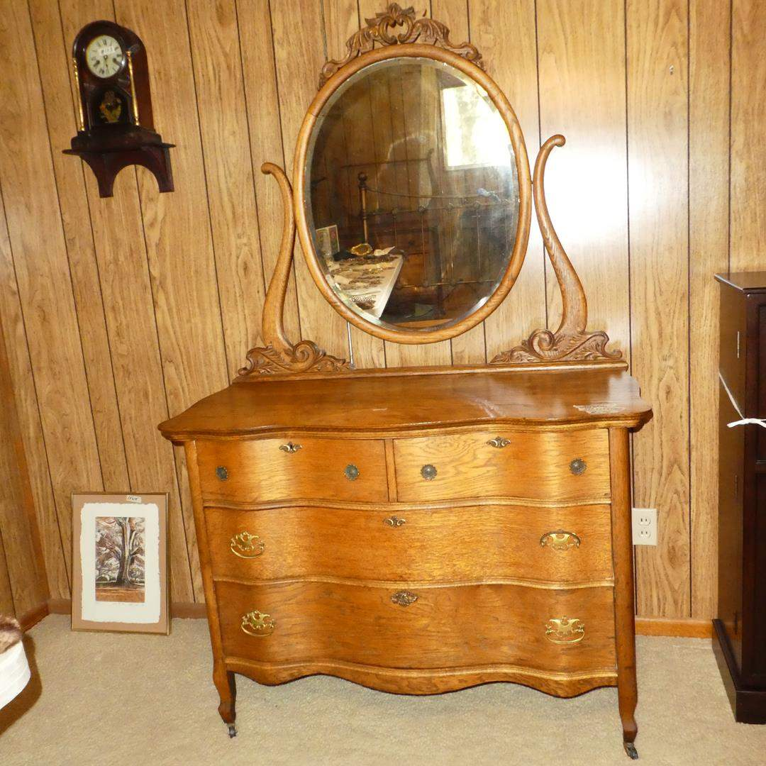 Lot # 174 - Antique Oak Serpentine 4 Drawer Dresser on Casters w/Dovetailed Drawers & Beveled Mirror (main image)