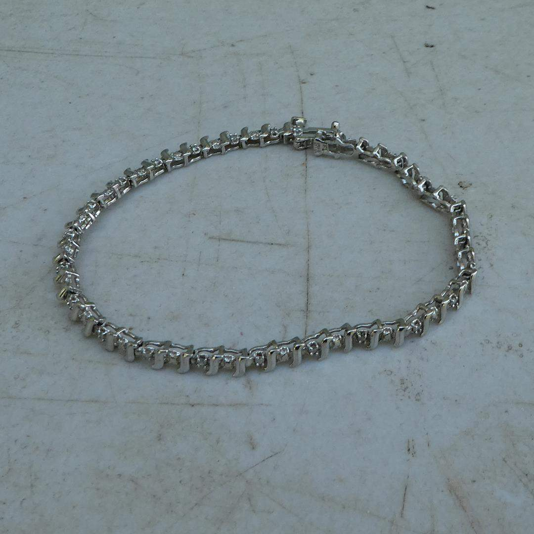 Lot # 187 - 14K White Gold Ladies Tennis Bracelet w/24 Small Diamonds (main image)