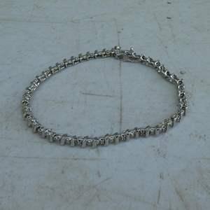 Lot # 187 - 14K White Gold Ladies Tennis Bracelet w/24 Small Diamonds