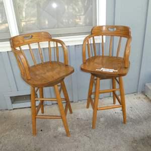 Lot # 52 - Two Solid Oak Swivel Bar Stools