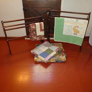 Lot # 63 -  Two Cute Quilt Racks and Handmade Machine Stitched Quilts (See Photos for Sizes)