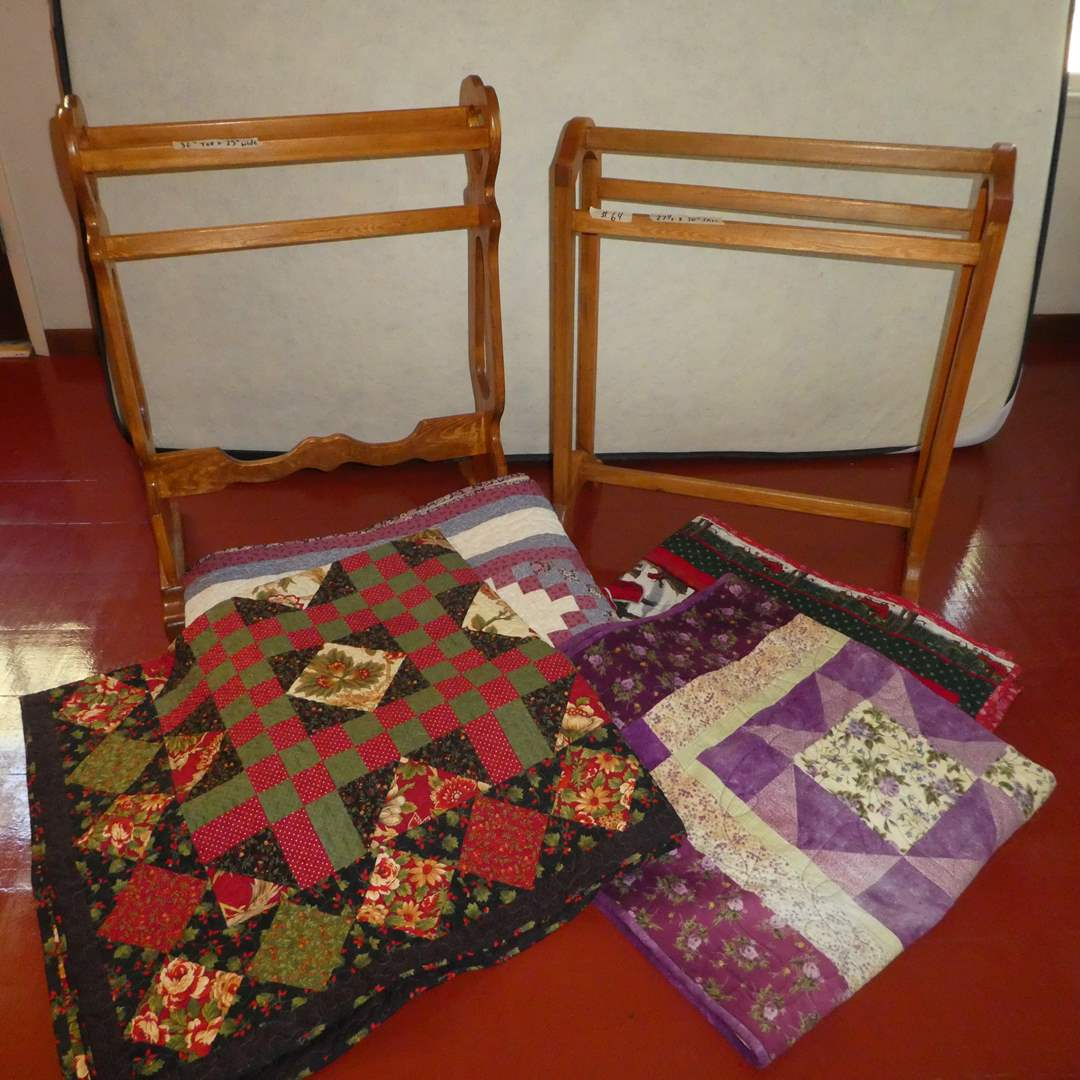 Lot # 64 - Two Cute Quilt Racks and Handmade Machine Stitched Quilts (See Photos for Sizes) (main image)