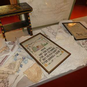 Lot # 65 - Framed Needle Work, Variety of Embroidered Napkins, Cute Wooden Painted Stool and More