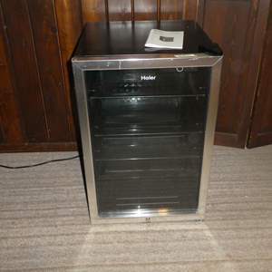 Lot # 82 - Haier Beverage Center Mini Fridge (Works)( See Photos for Dimensions)