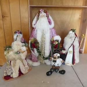Lot # 212 - Four Decorative Santa's