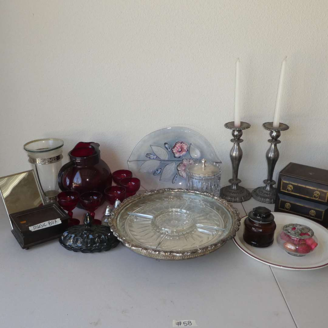 Lot # 58 - Vintage Lazy Susan Snack Dish, Plated Silver Candle Sticks, Jewelry Box, Red Glass Pitcher/ Stemware and More!