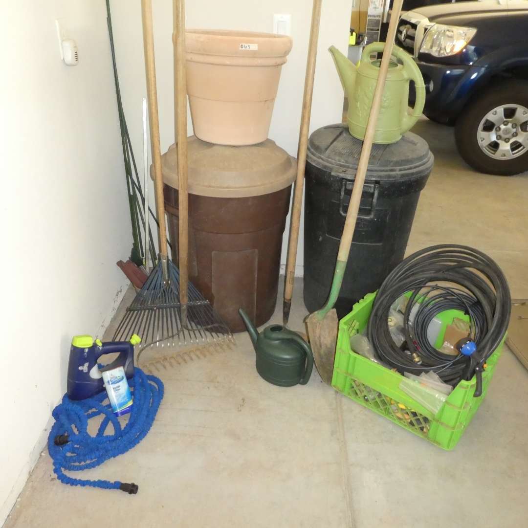 Lot # 63 - Garden Lot- Shovel, Rakes, Hoe, Two Trash Bins, Plastic Watering Cans, Tubing/ PVC Pieces and Car Wash Hose