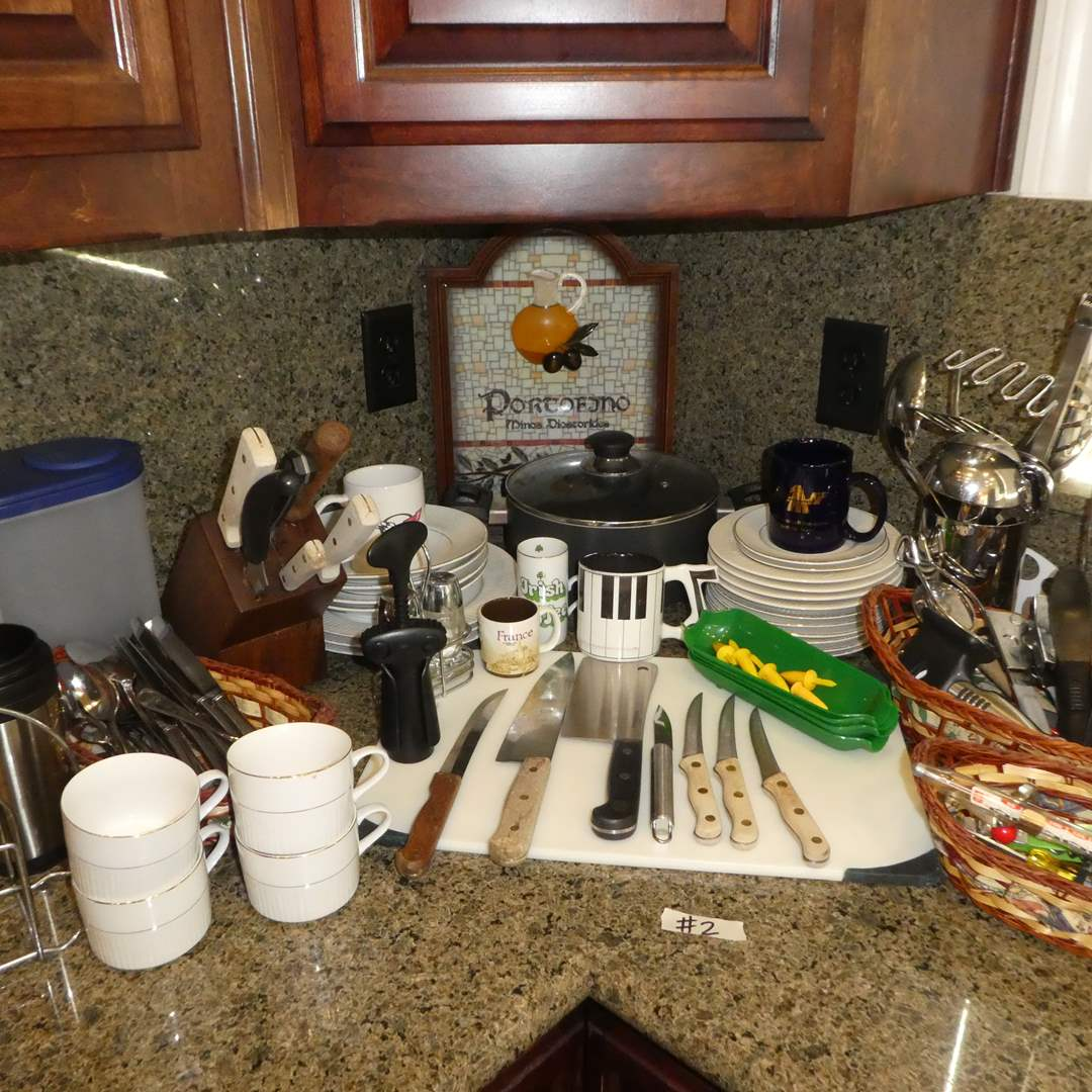 Lot # 2 - Kitchen Lot - Cutting Board, Misc Flatware, Coffee Cups, Baskets, Misc Cups, Plates, Knives and More!