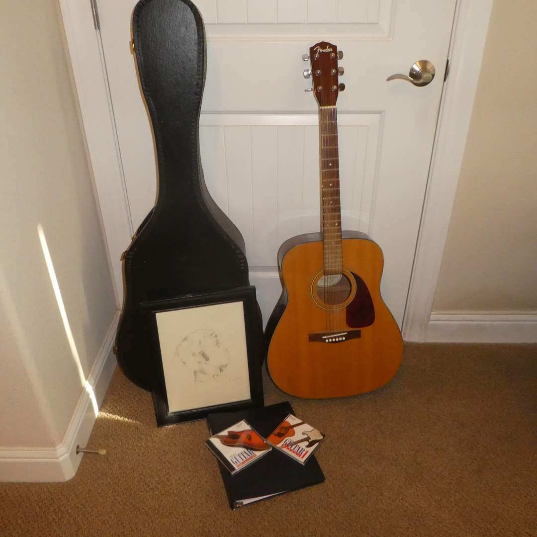 Lot # 27 - Fender Guitar and Case w/ Sheet Music (main image)