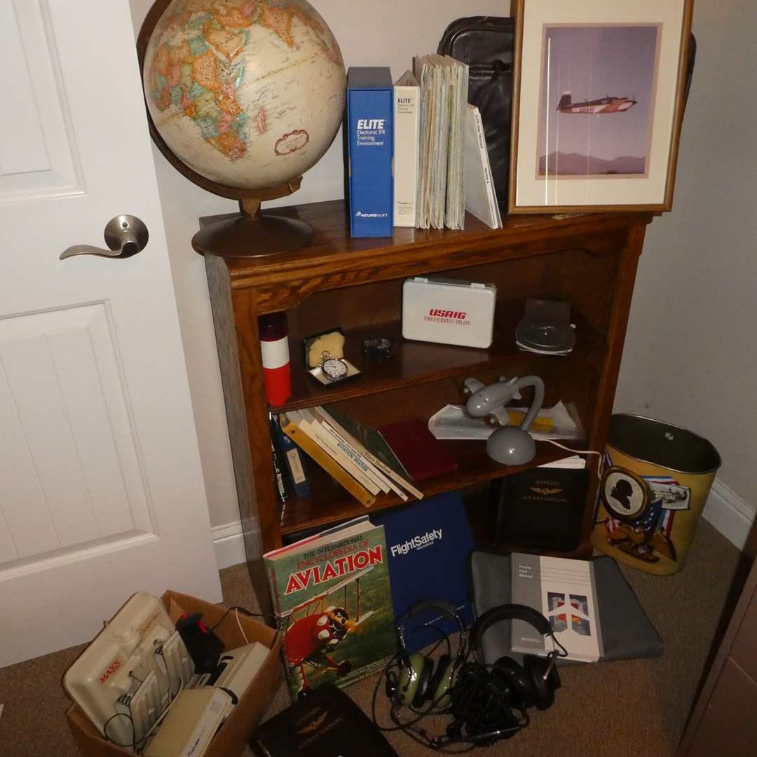 Lot # 30 - Huge Aviation Lot- Flight Training Books, Headsets, Vintage Azure Soft Flight Simulator, Flight Bag, Globe and More! (main image)