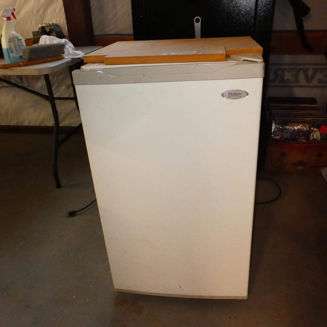 Lot # 111 - Small Haier Refrigerator - Wood Glued on Top (main image)