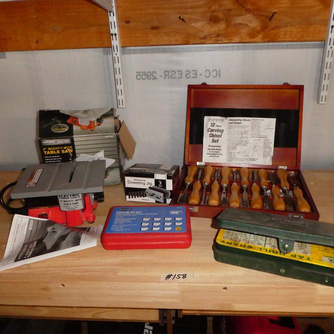 """Lot # 158 - Chicago Electric 4"""" Mighty Mite Table Saw, Security Bit Set, Doweling Jig, Tap & Die Set & Chisel Set"""