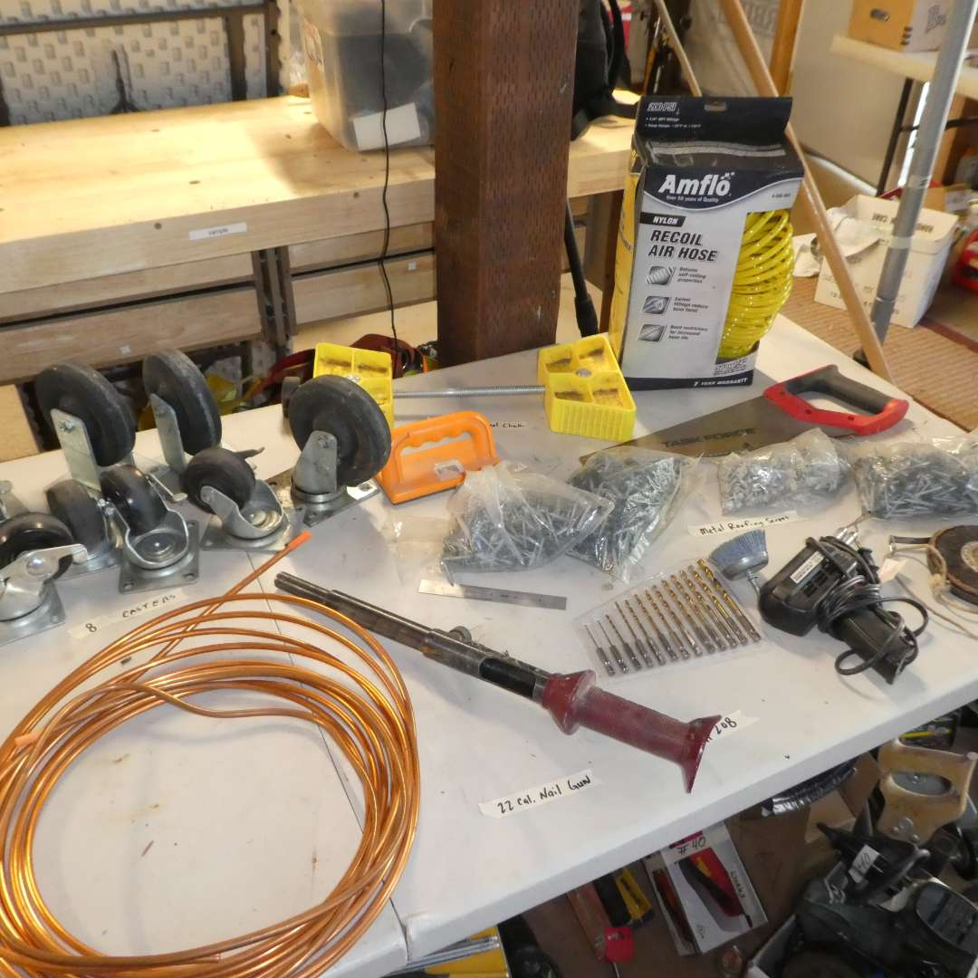 Lot # 208- Misc. Hardware Lot, Casters, Amflo Air Hose, Saw, Drill Bits and More