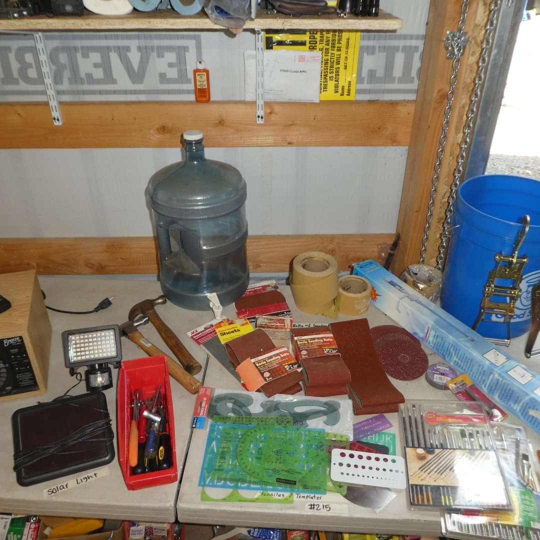 Lot # 215- 5 Gallon Water Jug, Water Bottle Pump, San Paper, Hammers,Solar Light, Air Purifier, Stencils and More