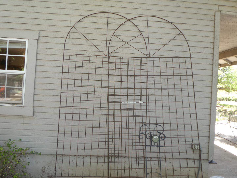 Lot # 157 - Pair Tall Metal Trellises & Metal Stake Garden Hose Stand (main image)