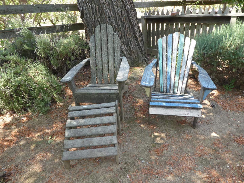 Lot # 158 - Two Adirondack Teak Chairs & Footstool - Weathered